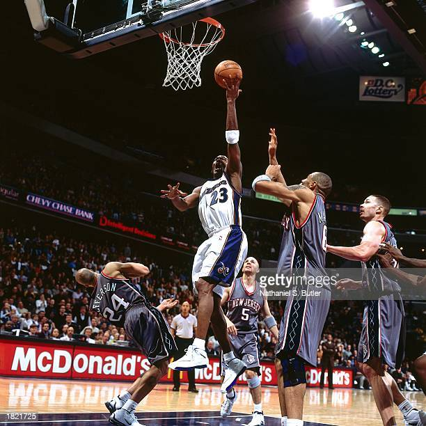 Michael Jordan of the Washington Wizards drives to the basket against Richard Jefferson and Kenyon Martin of the New Jersey Nets during the NBA game...