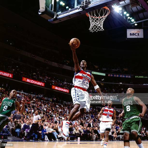 Michael Jordan of the Washington Wizards drives to the basket for a layup during his final NBA game against the Boston Celtics at the MCI Center on...