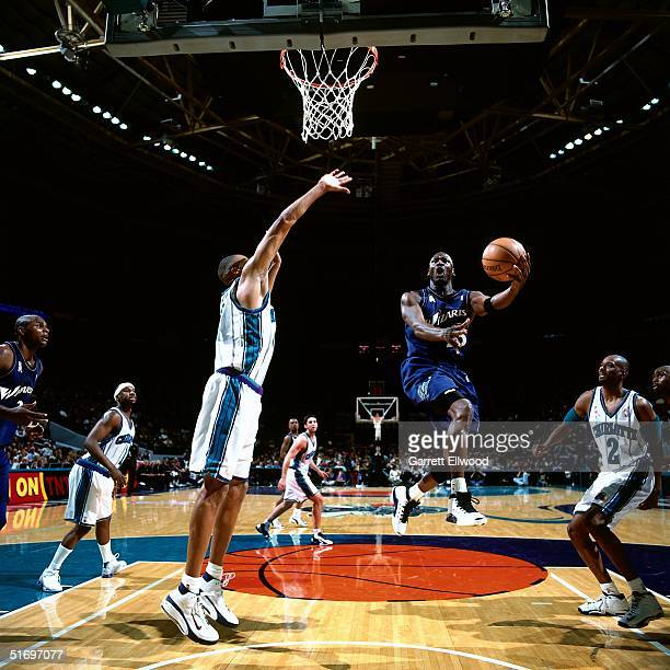 Michael Jordan of the Washington Wizards drives to the basket for a layup against the Charlotte Hornets on December 26, 2001 during an NBA game at...