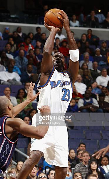 Michael Jordan of the Washington Wizards goes up for a jumper during the game against the New Jersey Nets at MCI Center on November 2 2002 in...