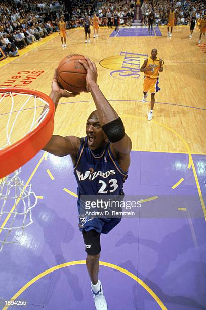 Michael Jordan of the Washington Wizards goes up for the dunk during the game against the Los Angeles Lakers at Staples Center on March 28 2003 in...