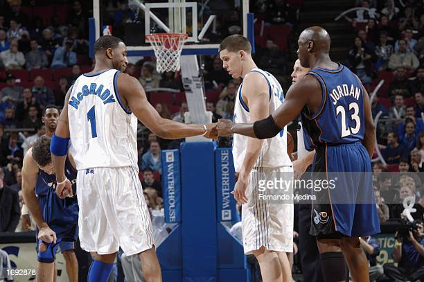 614394b72fb Michael Jordan of the Washington Wizards greets Tracy McGrady of the Orlando  Magic during the NBA