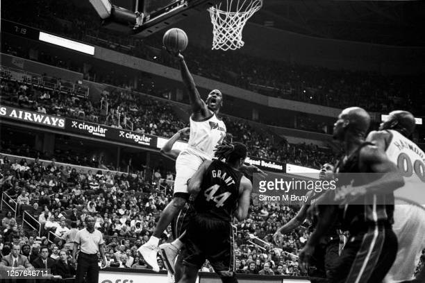 Michael Jordan of the Washington Wizards in action against Brian Grant of the Miami Heat at the MCI Center on March 15th 2003 in Washington DC.