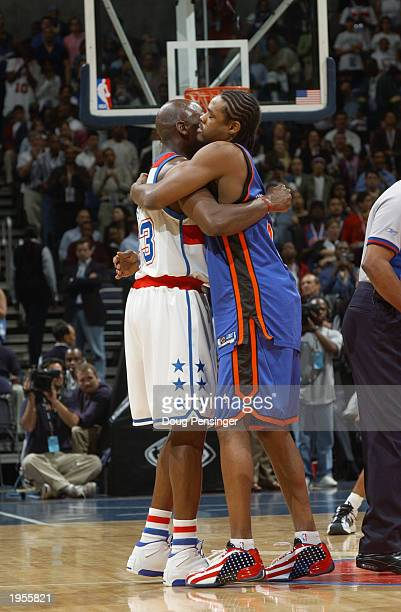 Michael Jordan of the Washington Wizards is greeted by Latrell Sprewell of the New York Knicks prior to tip off as Michael Jordan plays his final...