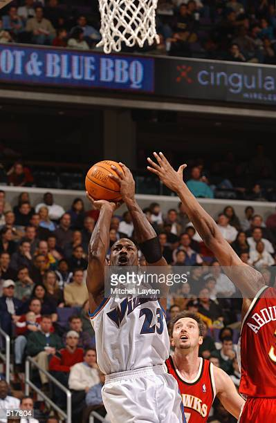 Michael Jordan of the Washington Wizards puts a shot up during the game against the Atlanta Hawks at the MCI Center in Washington District of...