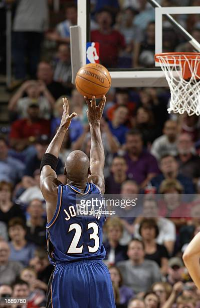 Michael Jordan of the Washington Wizards shoots a free throw against the Phoenix Suns during the game at America West Arena on March 21 2003 in...