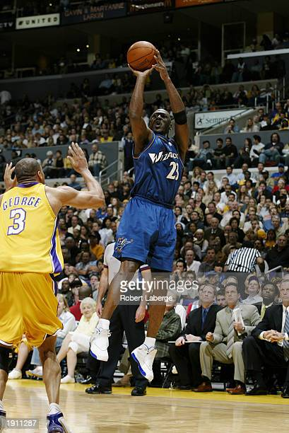 Michael Jordan of the Washington Wizards shoots a jump shot over Devean George of the Los Angeles Lakers during the game at Staples Center on March...