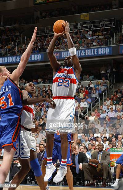 Michael Jordan of the Washington Wizards shoots a jump shot over Michael Doleac of the New York Knicks during Jordan's final home game at MCI Center...