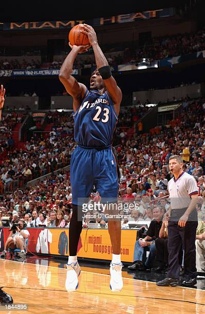 Michael Jordan of the Washington Wizards shoots against the Miami Heat during the game at American Airlines Arena on March 2 2003 in Miami Florida...