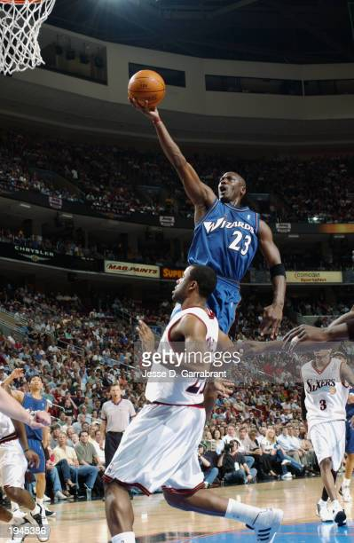Michael Jordan of the Washington Wizards shoots over Greg Buckner of the Philadelphia 76ers during the game at First Union Center on April 16, 2003...