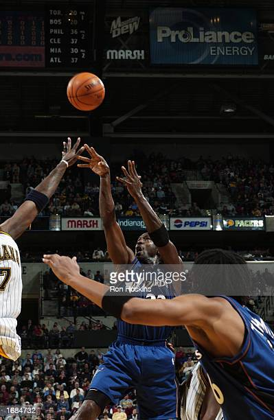 Michael Jordan of the Washington Wizards shoots over Jermaine O'Neal of the Indiana Pacers during the game at Conseco Fieldhouse on November 29 2002...
