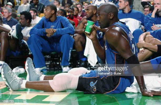 Michael Jordan of the Washington Wizards sits on the sideline icing his knees during the NBA preseason game against the Boston Celtics at Fleet...