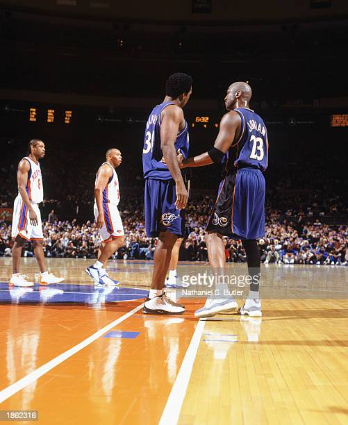 559dae0176 Michael Jordan of the Washington Wizards stands alongside Charles Oakley  during the game against the New