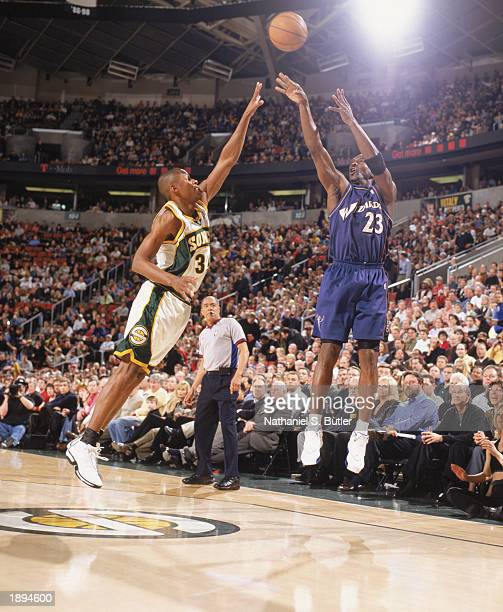 Michael Jordan of the Washington Wizards takes a jump shot over Ray Allen of the Seattle Sonics during the NBA game at Key Arena on March 26 2003 in...