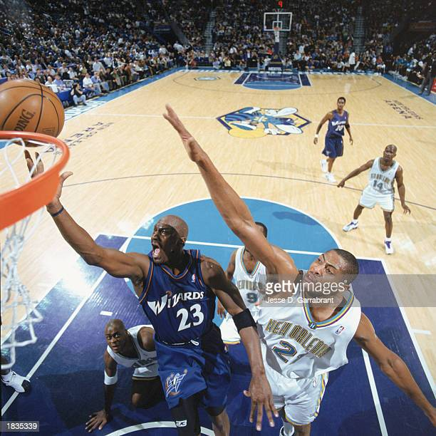 Michael Jordan of the Washington Wizards takes the layup against Jamaal Magloire of the New Orleans Hornets during the game at New Orleans Arena on...