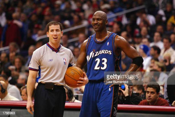 Michael Jordan of the Washington Wizards talks with referee Tim Donaghy during the game against the Los Angeles Clippers on February 12, 2003 at...