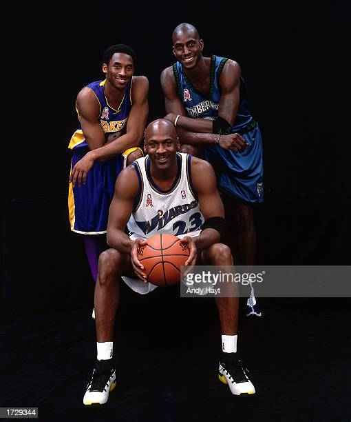 Michael Jordan of the Wizards poses for a portrait with Kobe Bryant and Kevin Garnett during the 2002 NBA AllStar Week at the First Union Center on...