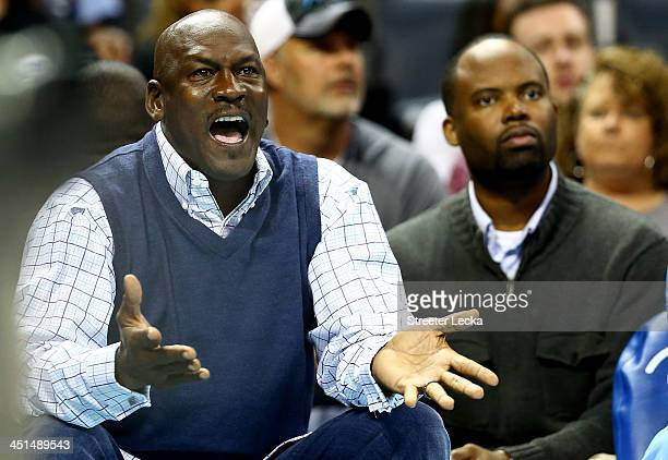 Michael Jordan owner of the Charlotte Bobcats reacts to a call as he sits on the bench during their game against the Phoenix Suns at Time Warner...