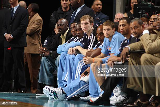 Michael Jordan Owner of the Charlotte Bobcats sits with his team during the game against the Chicago Bulls at the Time Warner Cable Arena on April 16...