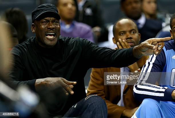 Michael Jordan, owner of the Charlotte Bobcats, yells at a referee after a call during their game against the Brooklyn Nets at Time Warner Cable...