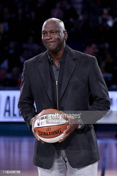 Michael Jordan, owner of the Charlotte Hornets, takes part in a ceremony honoring the 2020 NBA All-Star game during a break in play as Team LeBron...