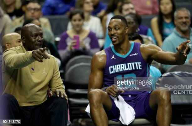 Michael Jordan owner of the Charlotte Hornets talks to Dwight Howard of the Charlotte Hornets during their game against the Utah Jazz at Spectrum...