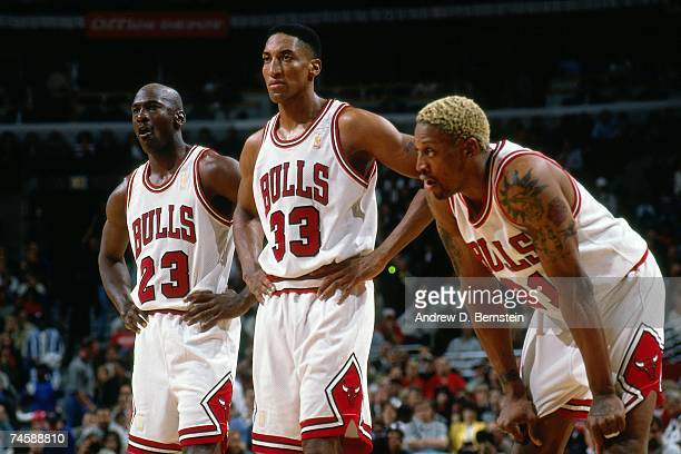Michael Jordan Scottie Pippen and Dennis Rodman of the Chicago Bulls catch their breath during a 1997 NBA game at the United Center in Chicago...