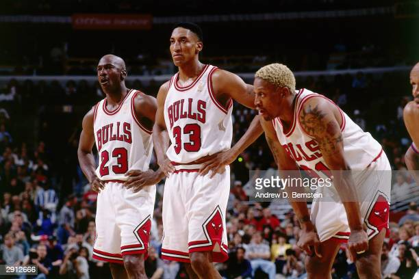 Michael Jordan, Scottie Pippen and Dennis Rodman the Chicago Bulls look on during a break in game action during the NBA Eastern Conference Finals...