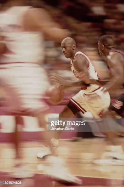 Michael Jordan, Shooting Guard and Small Forward for the Chicago Bulls dribbles the basketball down court during the NBA Central Division basketball...