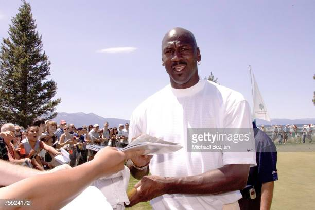 Michael Jordan signs an autograph at the American Century Championship Golf Tournament at the Edgewood Tahoe Golf Course in Lake Tahoe Nevada on July...