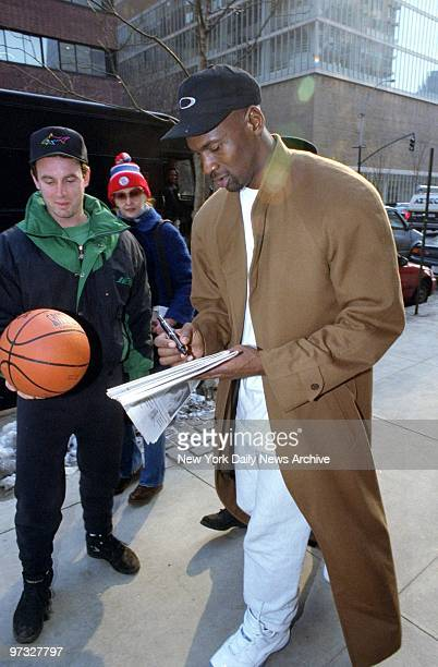 Michael Jordan signs autographs outside the Reebok Sports Club