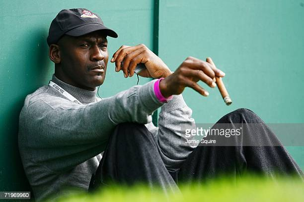 Michael Jordan smokes a cigar and watches the action during the morning fourballs of the first day of the 2006 Ryder Cup at The K Club on September...