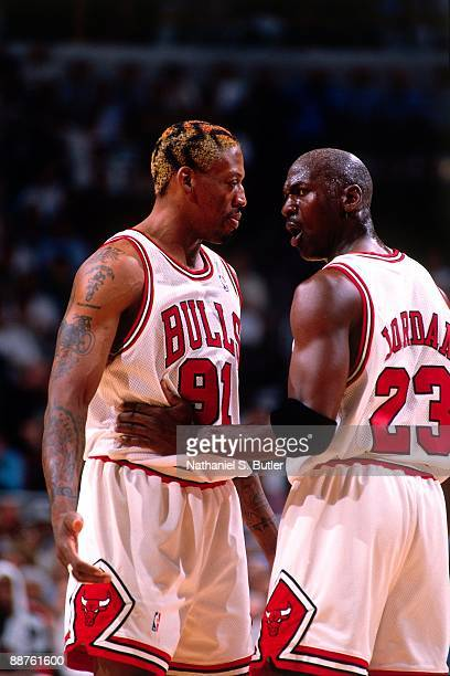Michael Jordan talks to Dennis Rodman of the Chicago Bulls in Game Five of the Eastern Conference Finals during the 1998 NBA Playoffs at the United...