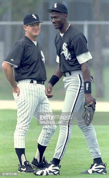 Michael Jordan talks with Chicago White Sox Manager Gene Lamont 19 February during the White Sox Spring Training Camp in Sarasota Jordan is attending...