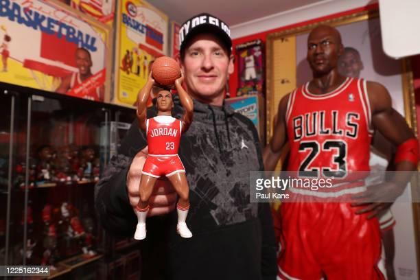 Michael Jordan toy historian Joshua De Vaney poses with a rare Ohio Art Lil' Sport Michael Jordan HORSE basketball figure prototype that never went...
