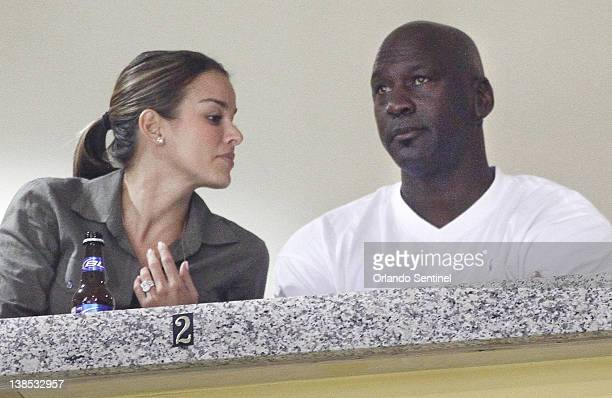 Michael Jordan with fiancee Yvette Prieto showing the engagement bling watches from a luxury box as Marshall visits Central Florida at the UCF Arena...
