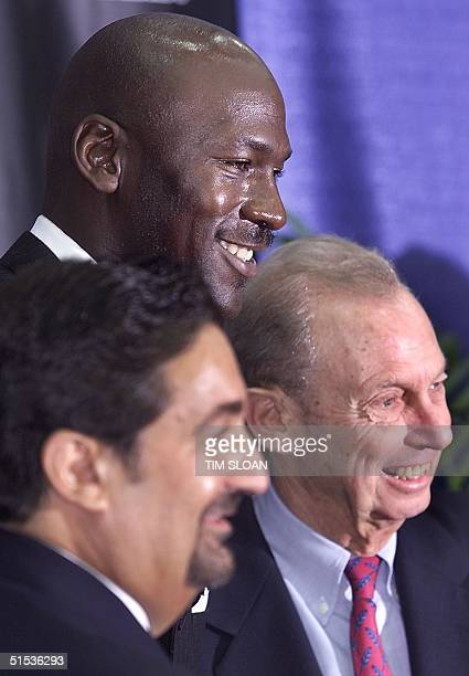Michael Jordan with Ted Leonsis minority owner and Abe Pollin owner of the Washington Wizards attend a press conference at MCI Center 19 January in...