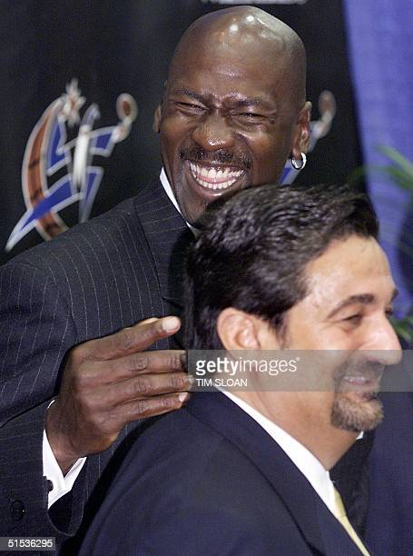 Michael Jordan with Ted Leonsis minority owner of the Washington Wizards attend a press conference at MCI Center 19 January in Washington DC where it...
