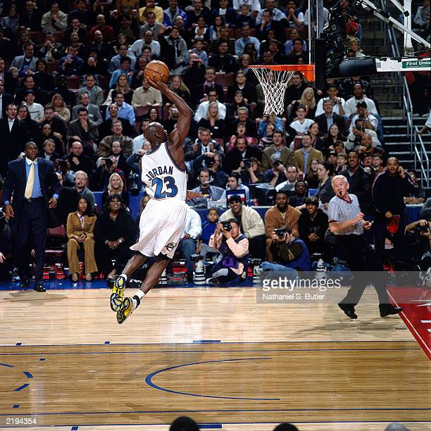 Michael Jordan#23 of the Eastern Conference AllStars attempts a dunk during the 2002 AllStar game circa 2002 in the First Union Center in...