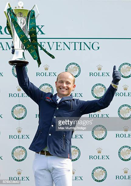 Michael Jung holds aloft the Rolex Grand Slam of Eventing Trophy after he won the Badminton Horse Trials following wins at Burghley and Kentucky on...