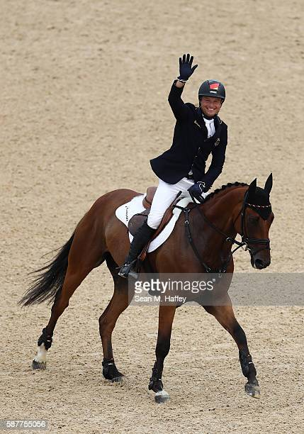 Michael Jung of Germany celebrates winning the gold medal for the eventing Individual final on Day 4 of the Rio 2016 Olympic Games at the Olympic...