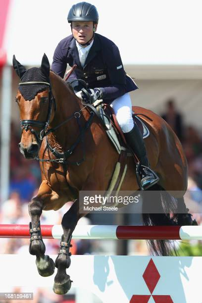 Michael Jung of Germany riding La BiosthetiqueSam Fbw on his way to second place during the showjumping test at Badminton horse trials on May 6 2013...