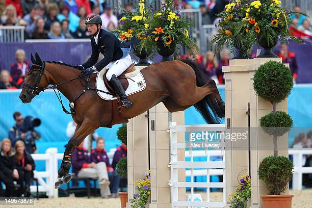 Michael Jung of Germany riding Sam negotiates a jump in the Individual Jumping Equestrian Final on Day 4 of the London 2012 Olympic Games at...