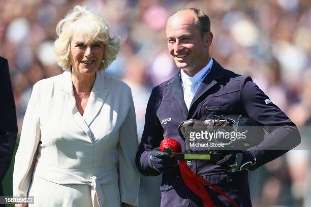 Michael Jung of Germany with the runners up trophy alongside CamillaDuchess of Cornwall after the showjumping test at Badminton horse trials on May 6...