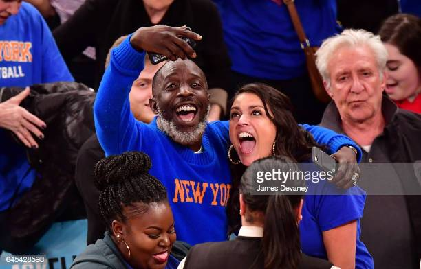 Michael K Williams and Cecily Strong attend Philadelphia 76ers Vs New York Knicks game at Madison Square Garden on February 25 2017 in New York City