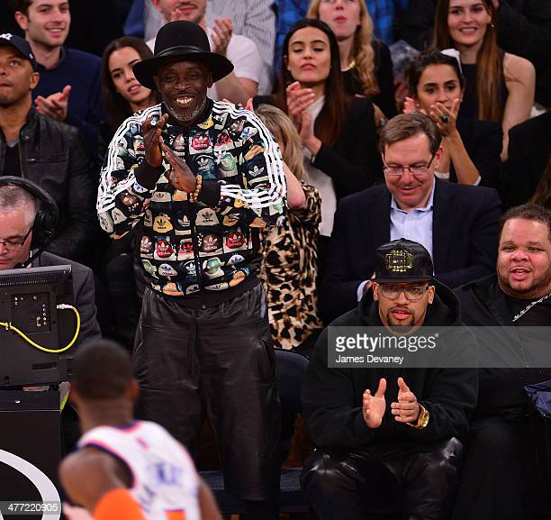 Michael K Williams and guest attend the Utah Jazz vs New York Knicks game at Madison Square Garden on March 7 2014 in New York City