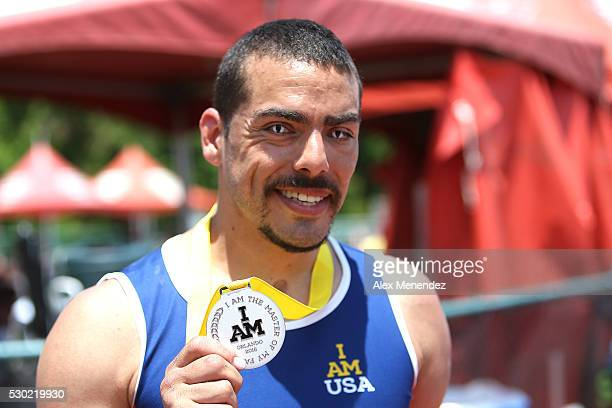 Michael Kacer poses with one of his medals during the Invictus Games Orlando 2016 Track Field Finals at the ESPN Wide World of Sports Complex on May...