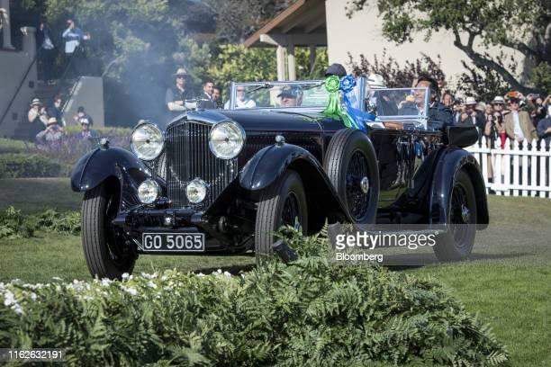 Michael Kadoorie, chairman of Hong Kong And Shanghai Hotels Ltd., left, drives his 1931 Bentley 8 litre Gurney Nutting Sport Tourer onto the winners...