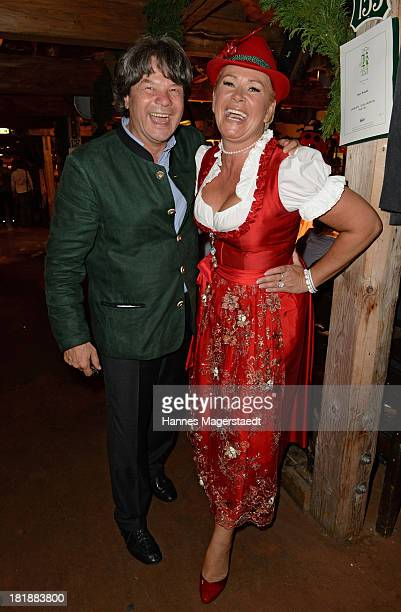 Michael Kaefer and Claudia Effenberg attend the Oktoberfest beer festival at the Kaefer tent on September 25 2013 in Munich Germany