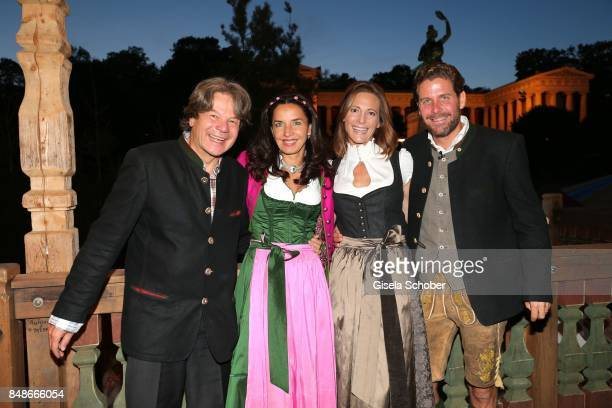 Michael Kaefer and his wife Clarissa Kaefer Philip Greffenius and his wife Evelyn Greffenius during the 'Almauftrieb' as part of the Oktoberfest 2017...